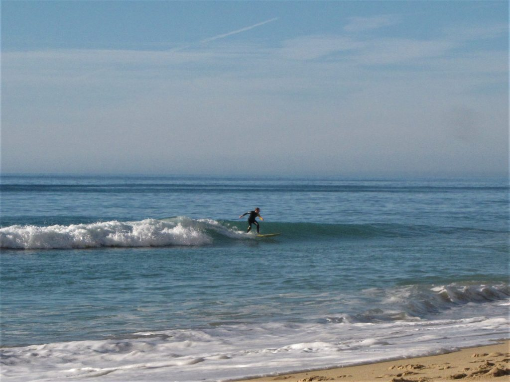 Annemarie goes left on a perfect small wave at Porto de Mos