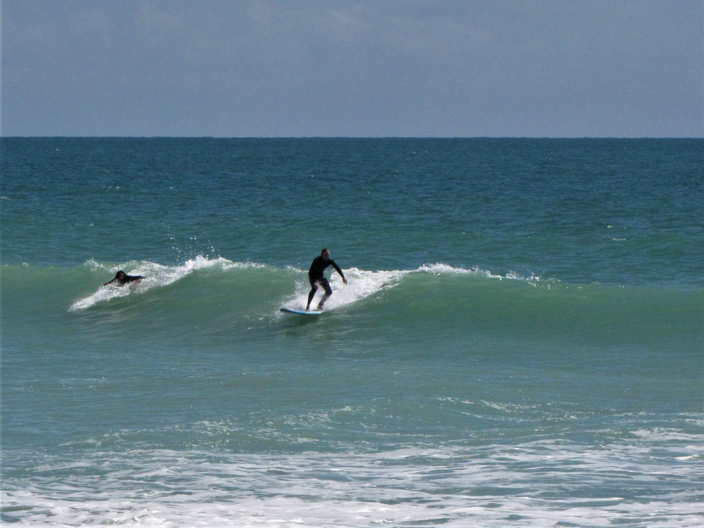 stoked dutch surfer on a wave in Lagos Algarve Portugal