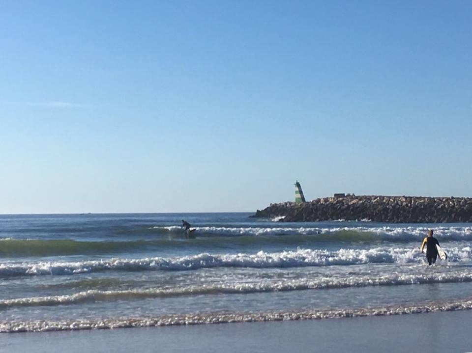 meia praia surfgirl walking in the water