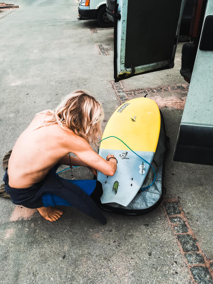 cordoama preparing surfboard